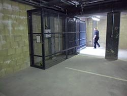 A security gate for an underground car park with a safety cage enclosing the return
