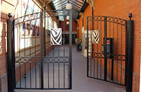 A bifolding pair of gates with stainless steel decoration
