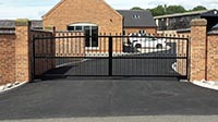 A wide sightly curved steel gate