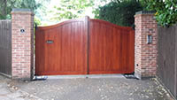 A Bakewell serpentine gate stained in dark oak