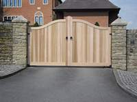 A Matlock style hardwood gate made with Iroko and treated with teak oil