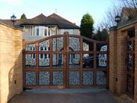 A Mickleover gate is a varient of the Uttoxeter gate with scroll infill instead of bars